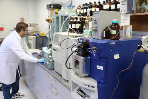Technician working on equipment in laboratory