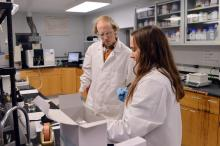 Two people working in laboratory